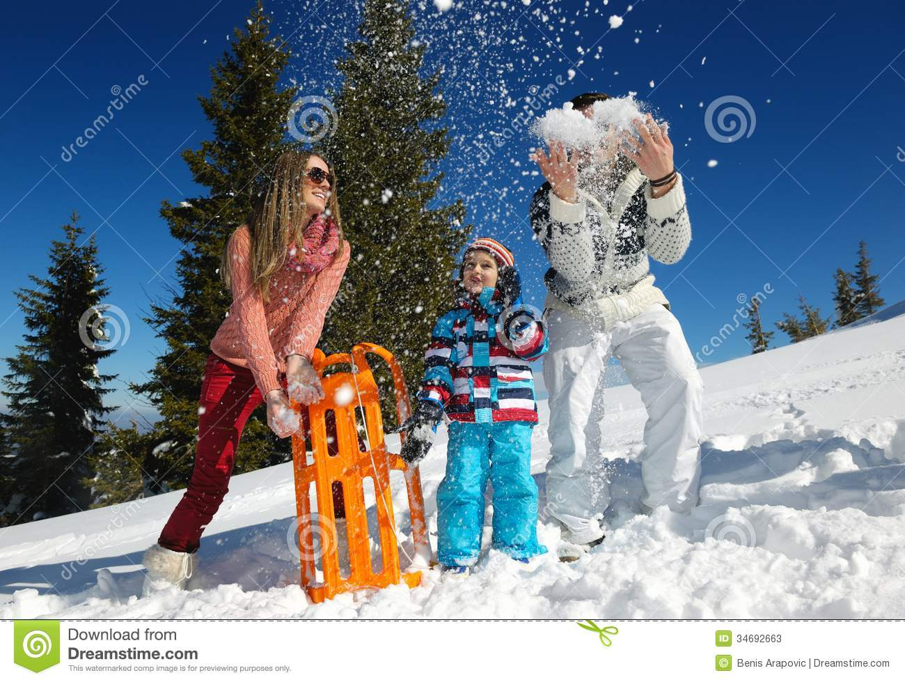 Family having fun on fresh snow at winter stock photos for Vacation in the snow
