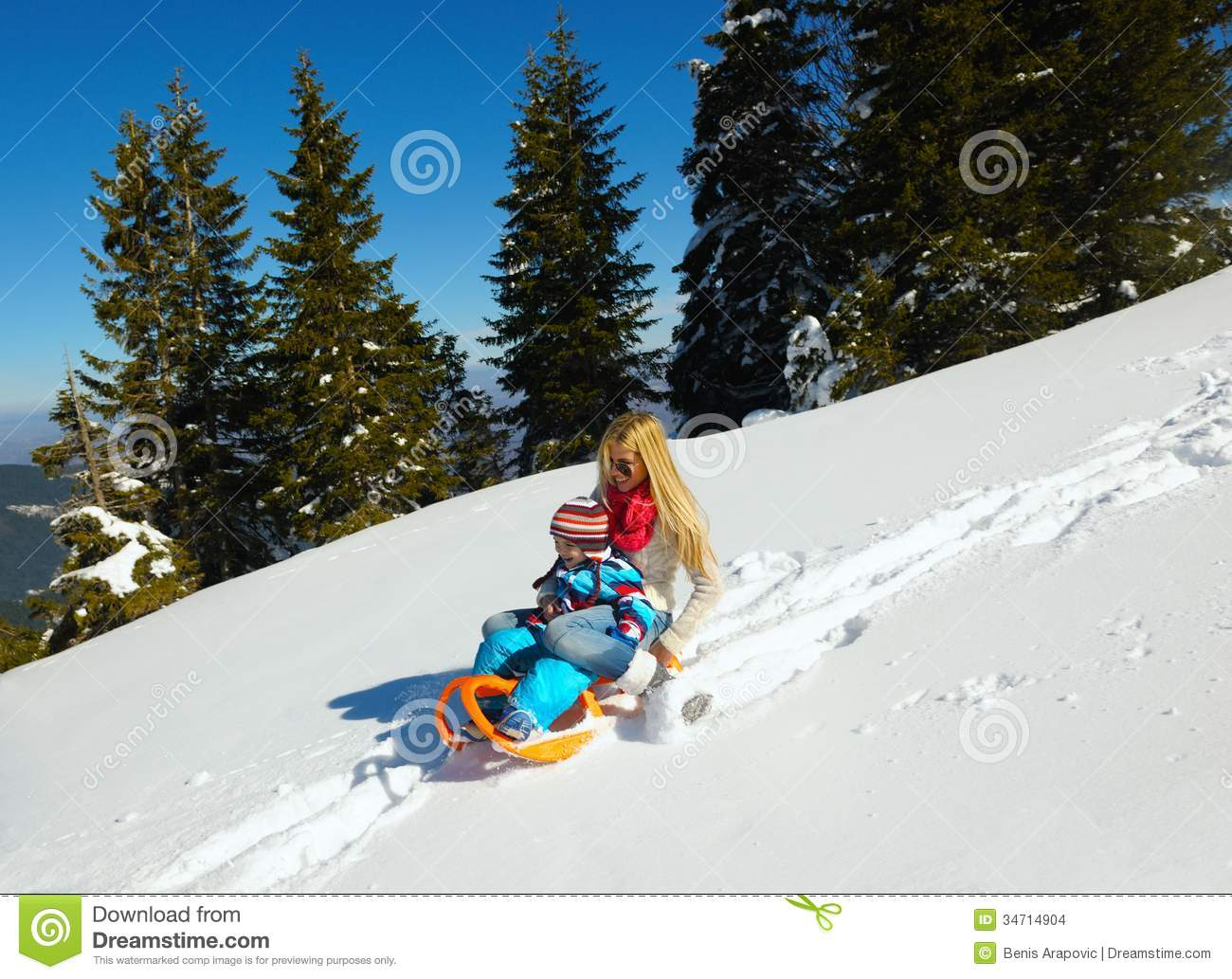 Family having fun on fresh snow at winter stock images for Vacation in the snow