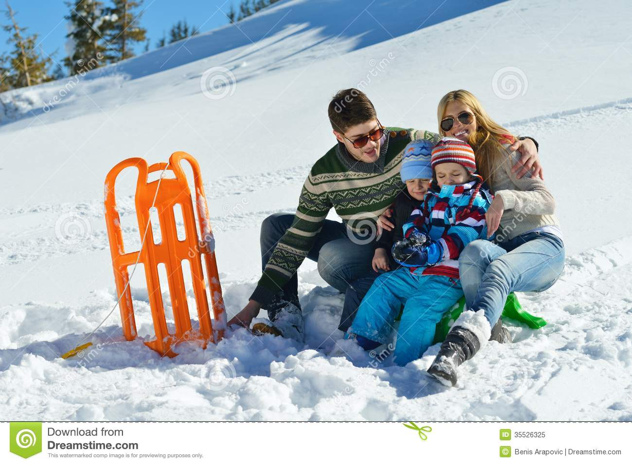 Family having fun on fresh snow at winter vacation royalty for Best family winter vacations