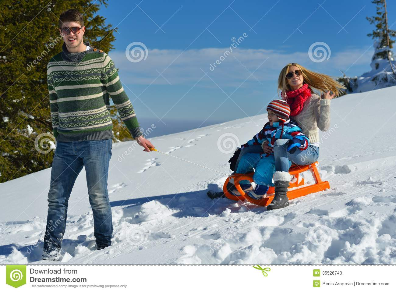 Family having fun on fresh snow at winter vacation stock for Best family winter vacations