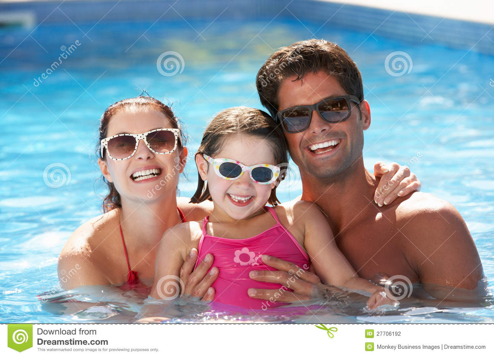 Stock Photography: Family Having Fun In Swimming Pool
