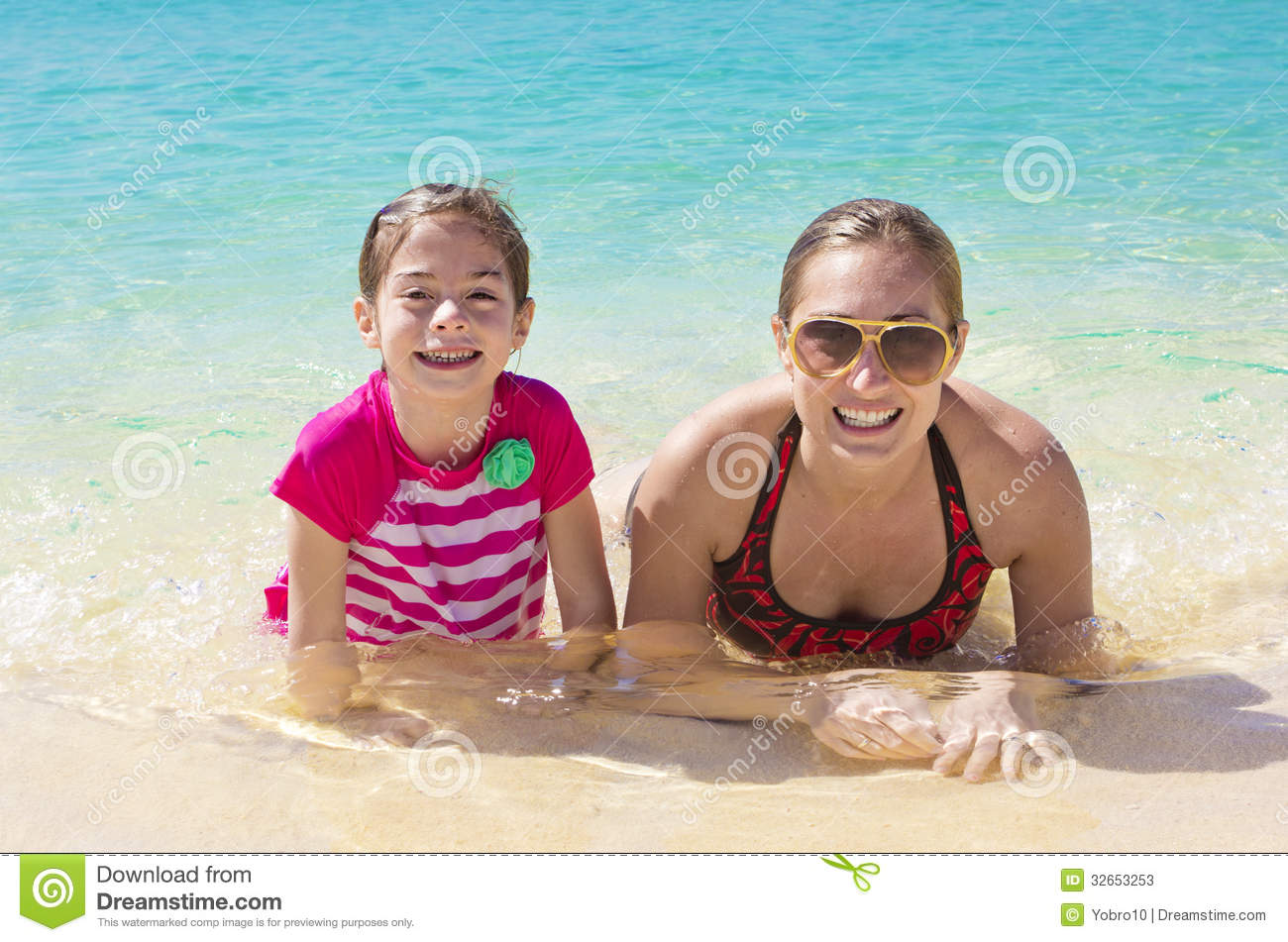 Family having fun on a tropical resort vacation stock for Best mother daughter weekend getaways
