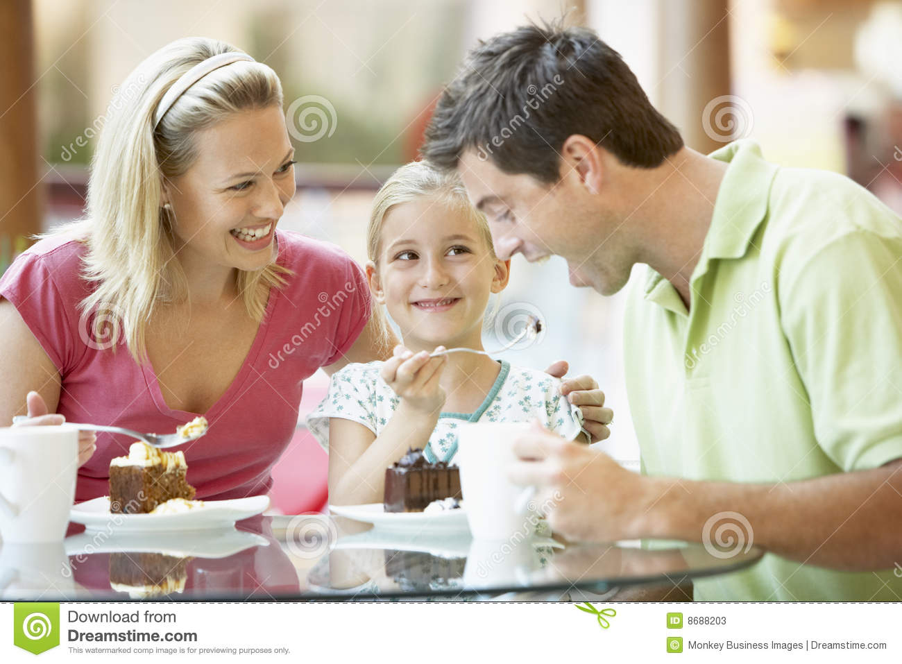 Family having lunch mall together