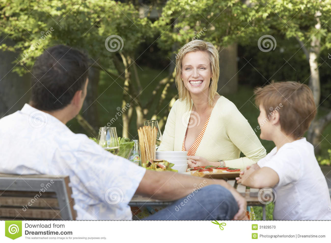 Family Having Meal At Picnic Table Stock Photo - Image of ...