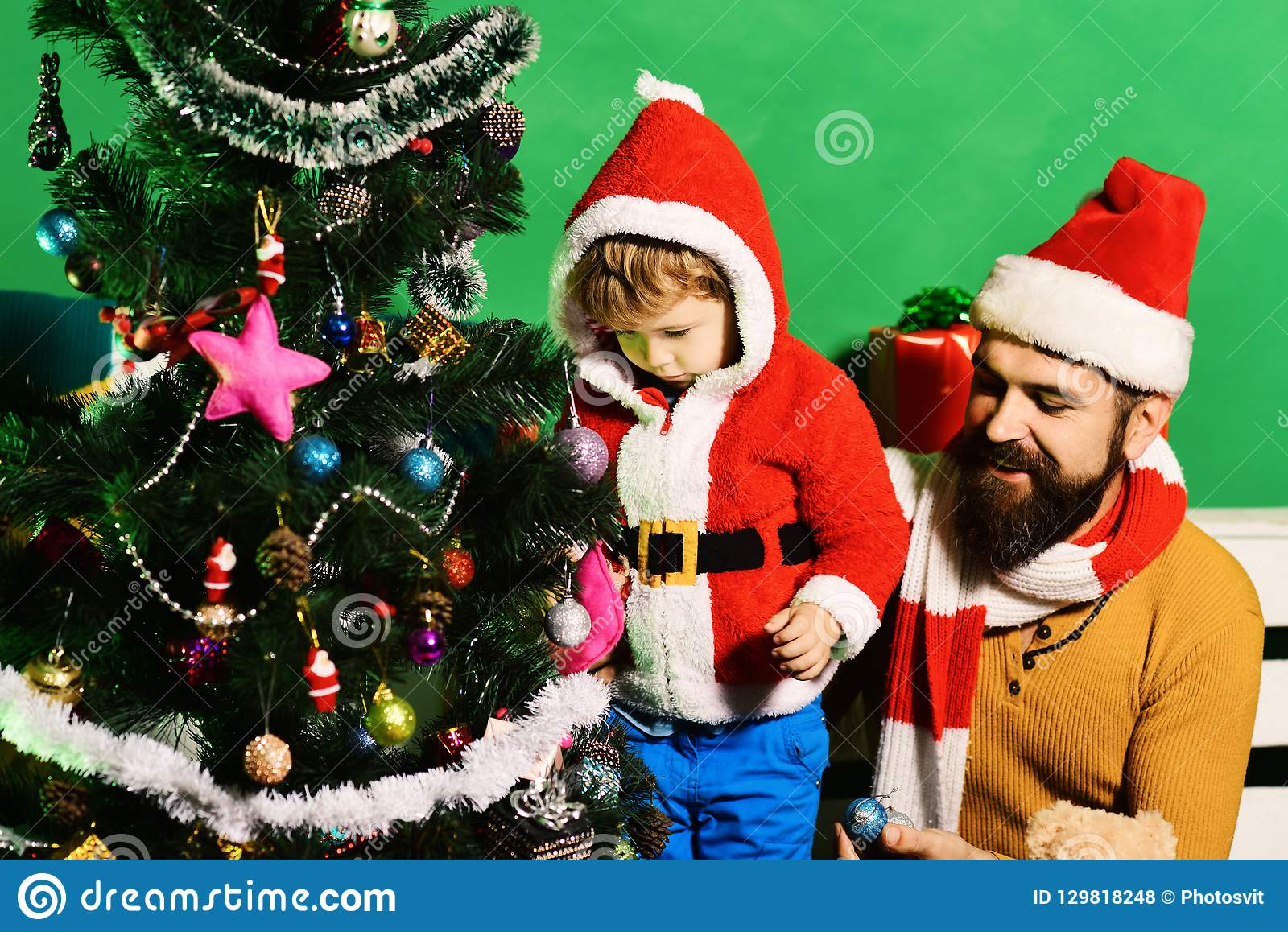 Family holidays concept. Boy and man with beard