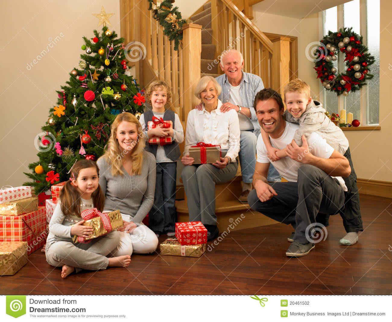 Family At Home Around Christmas Tree Stock Photography - Image ...