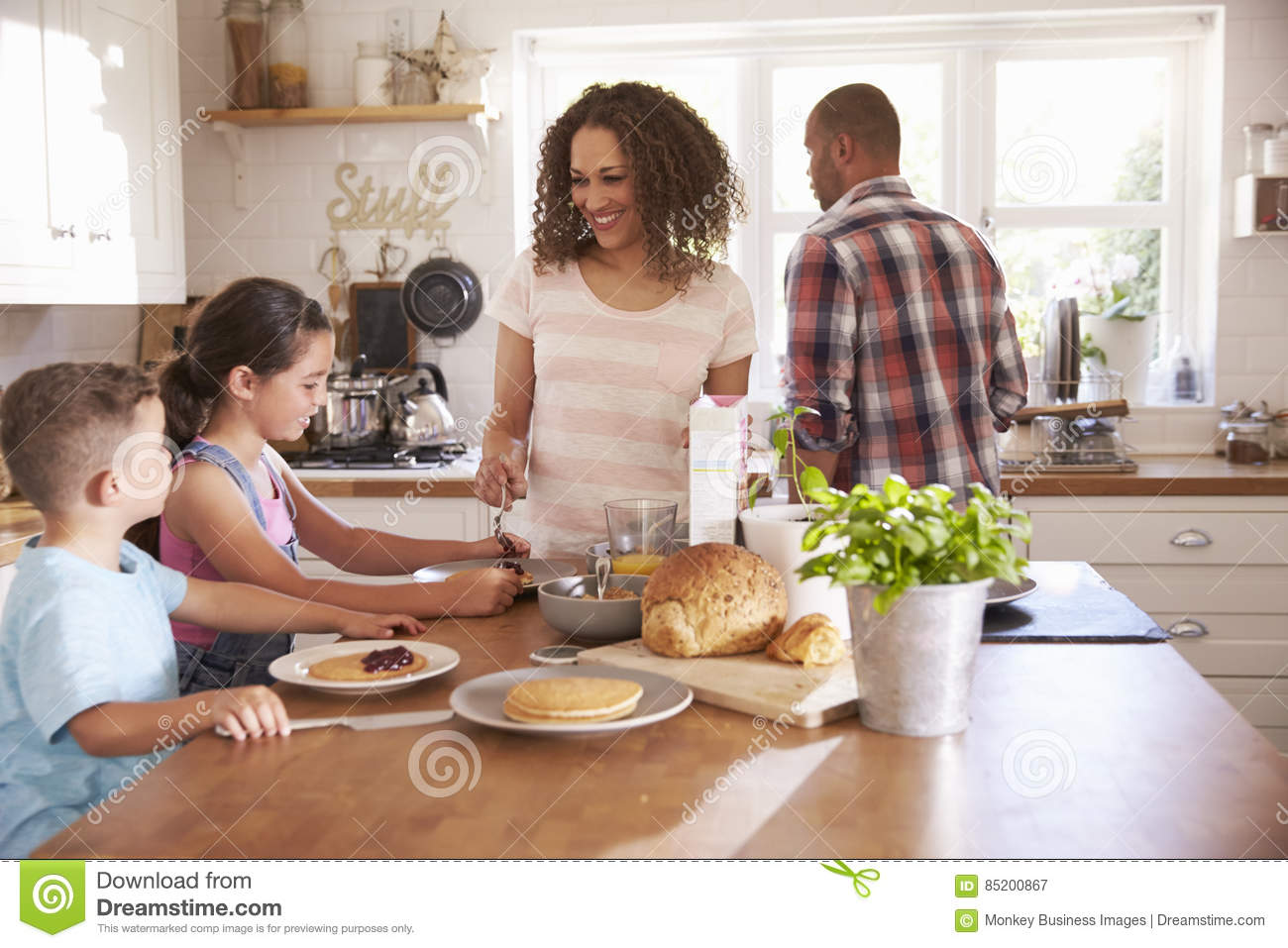 Download Family At Home Eating Breakfast In Kitchen Together Stock Image - Image of daughter, food: 85200867