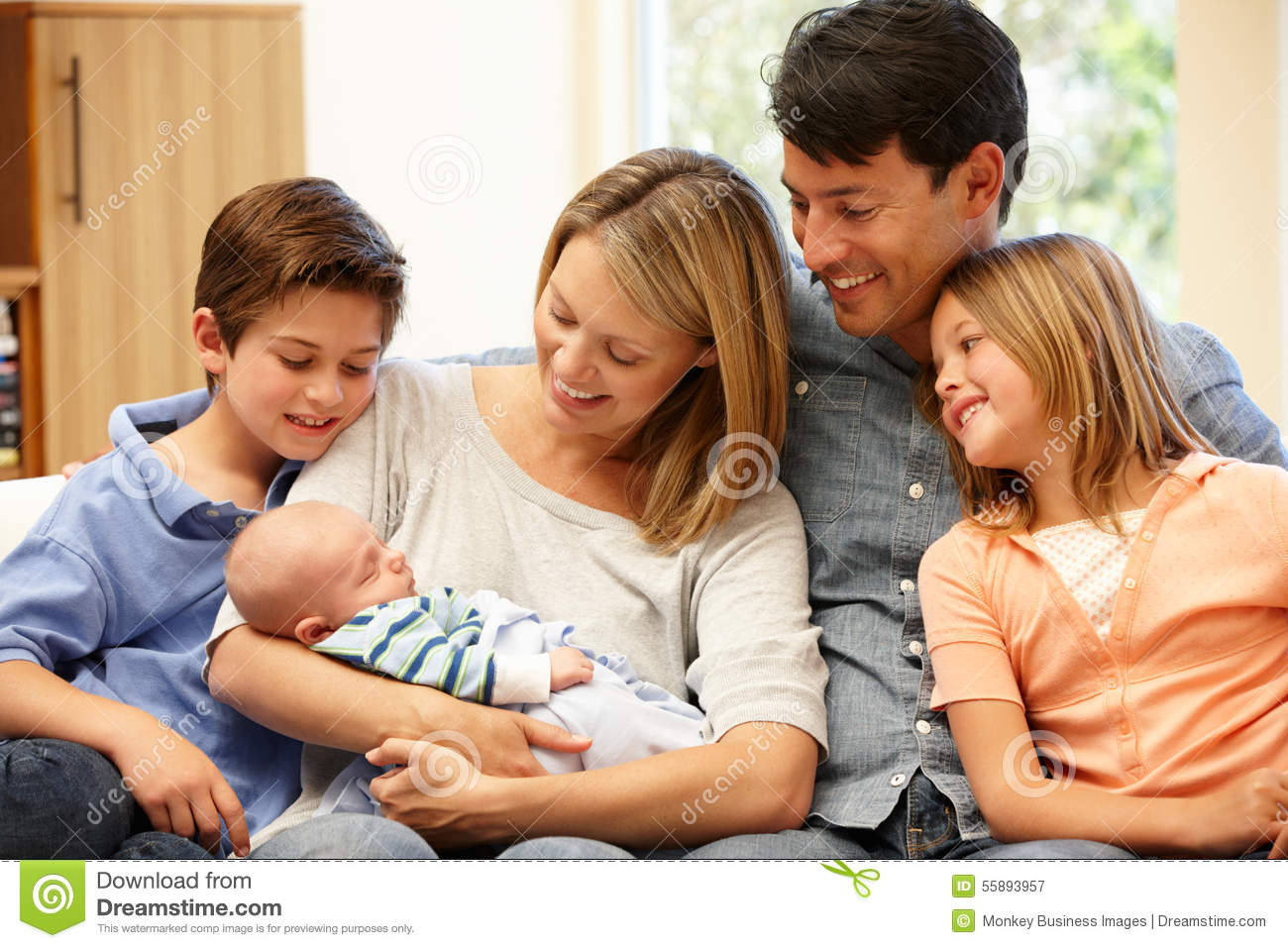 Family at home with new baby