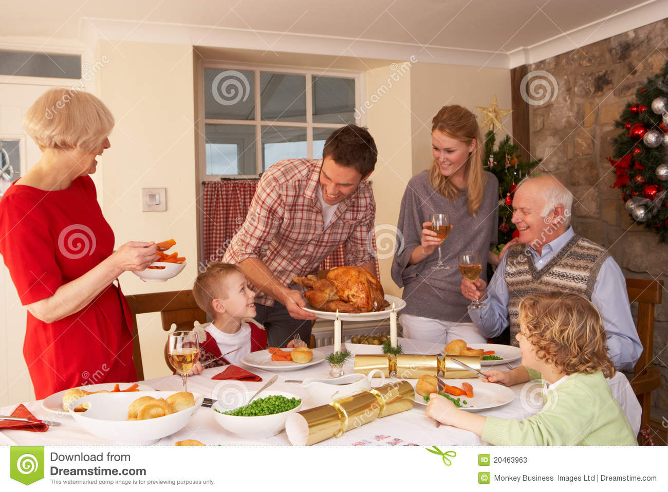Family At Home Serving Dinner At Christmas Stock Photos ...