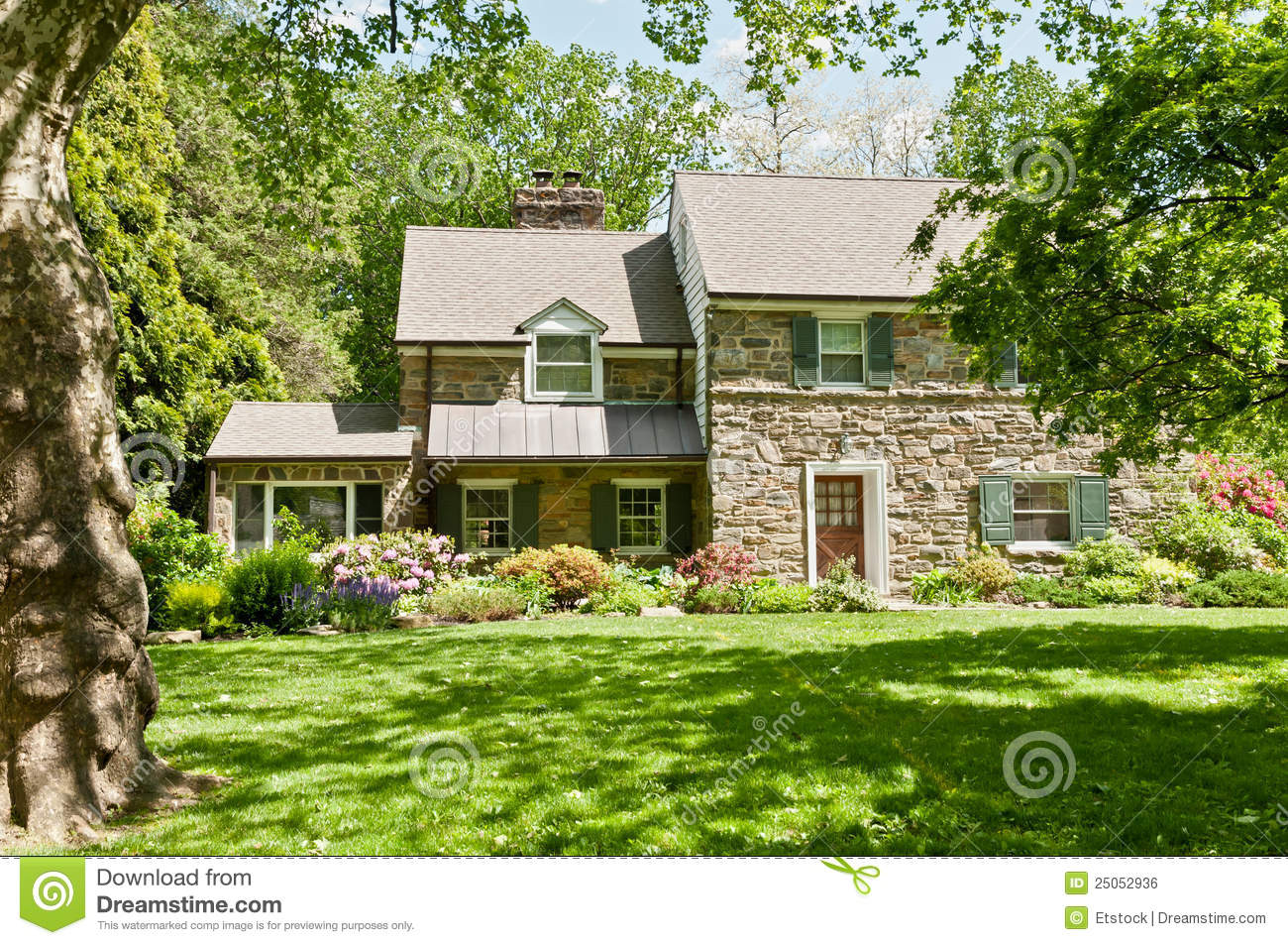 Family House With Front Lawn On Sunny Spring Day Royalty