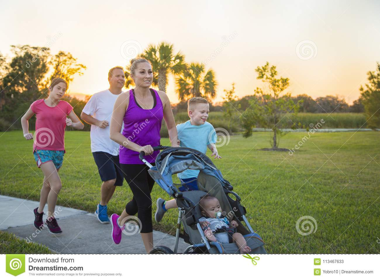Family jogging and exercising outdoors together