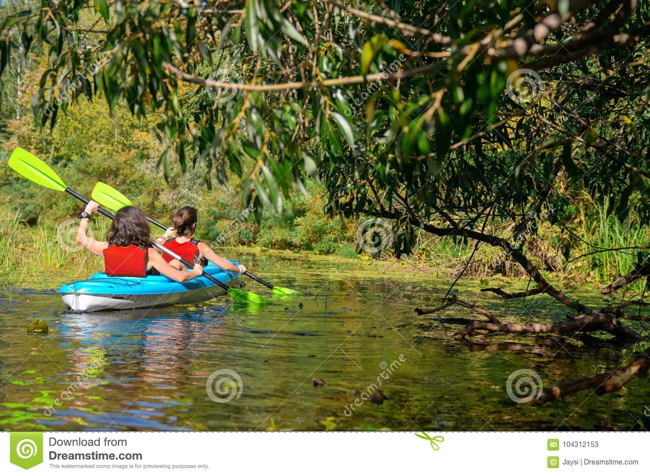 Family kayaking, mother and child paddling in kayak on river canoe tour, active summer weekend and vacation, sport and fitness