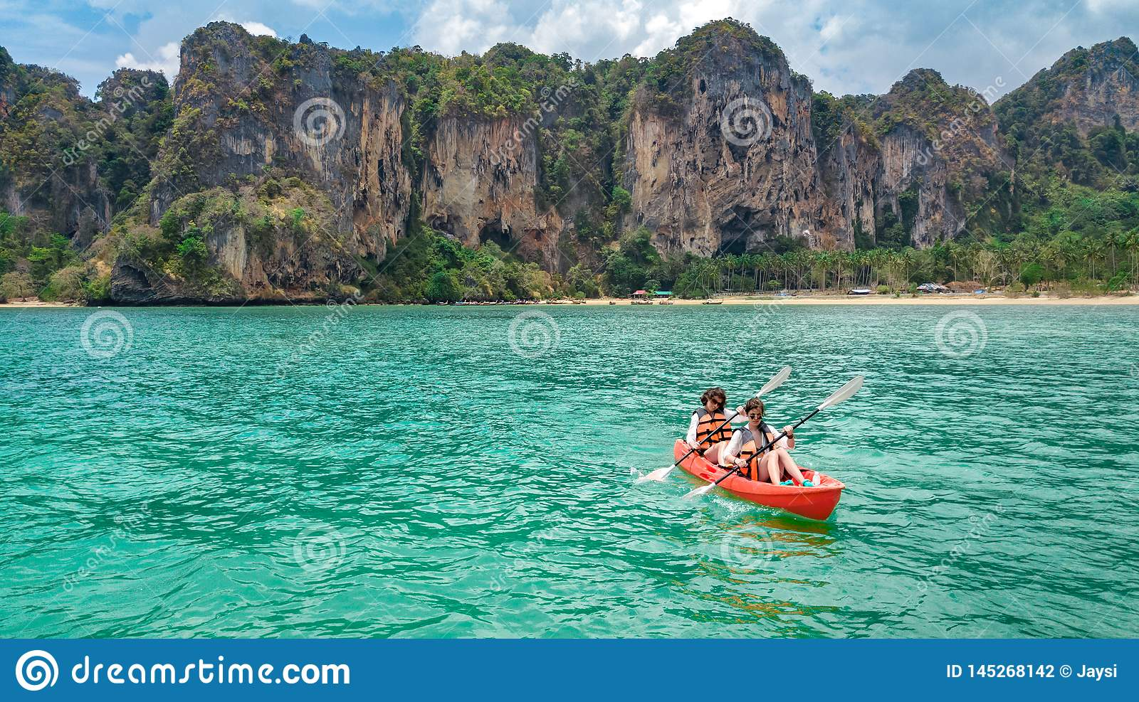 Family kayaking, mother and daughter paddling in kayak on tropical sea canoe tour near islands, having fun, vacation in Thailand