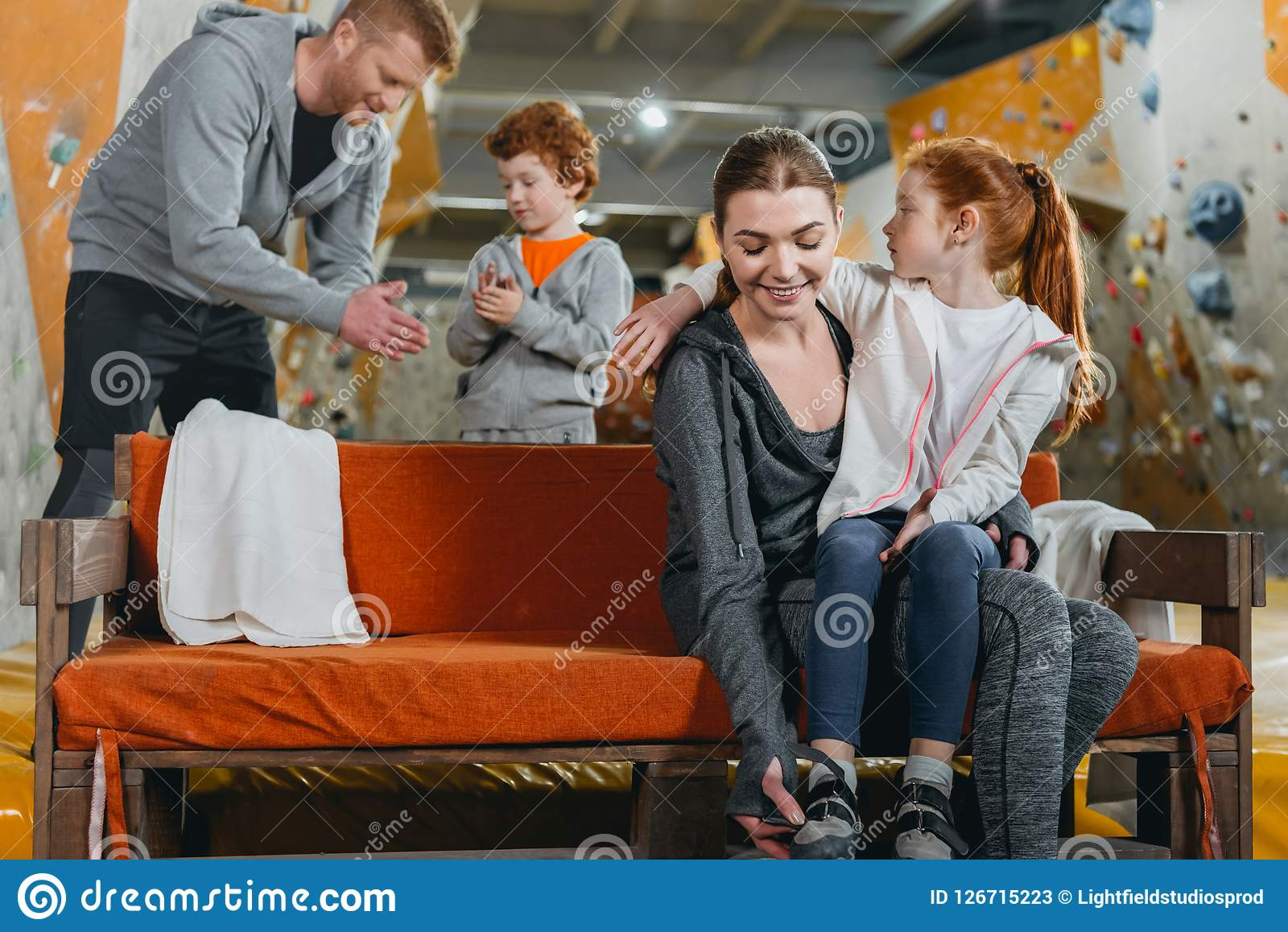 d8795da6106c A Family With Kids At Gym Changing Clothes And Preparing To Climb ...