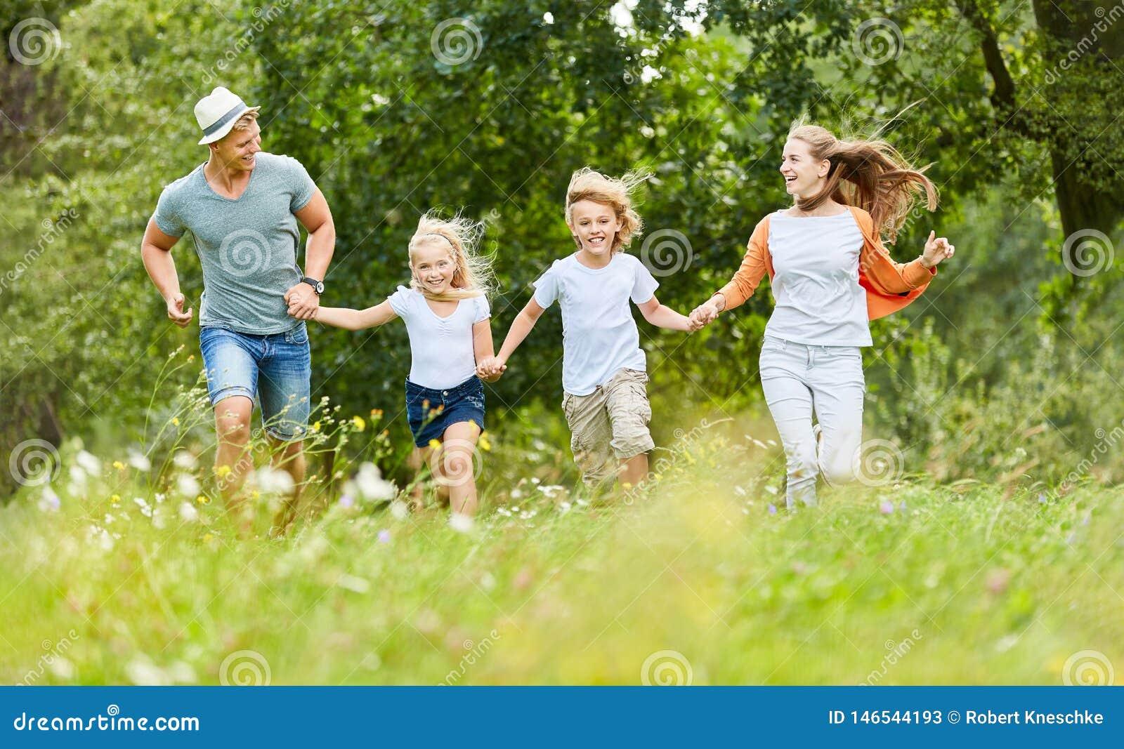 Family and children run in nature