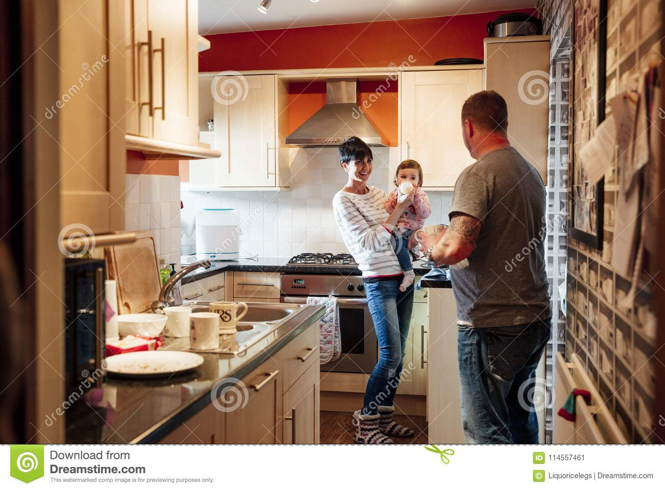 Family In The Kitchen With Baby Stock Image - Image of dairy
