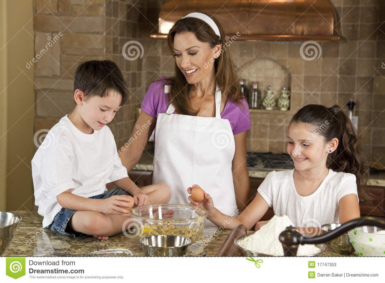 Family In Kitchen Cooking & Baking