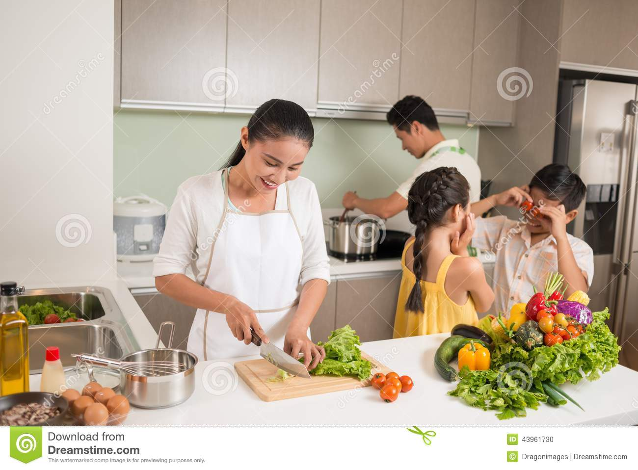 Family cooking kitchen - Family In The Kitchen Stock Photo