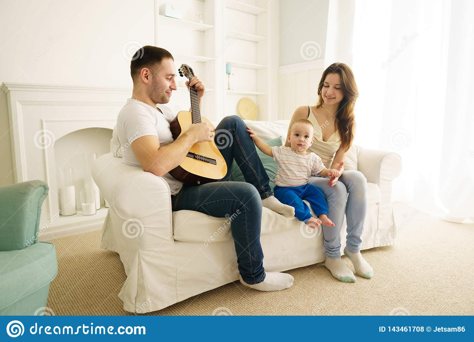 Family In Living Room, Leisure Activities Stock Photo ...