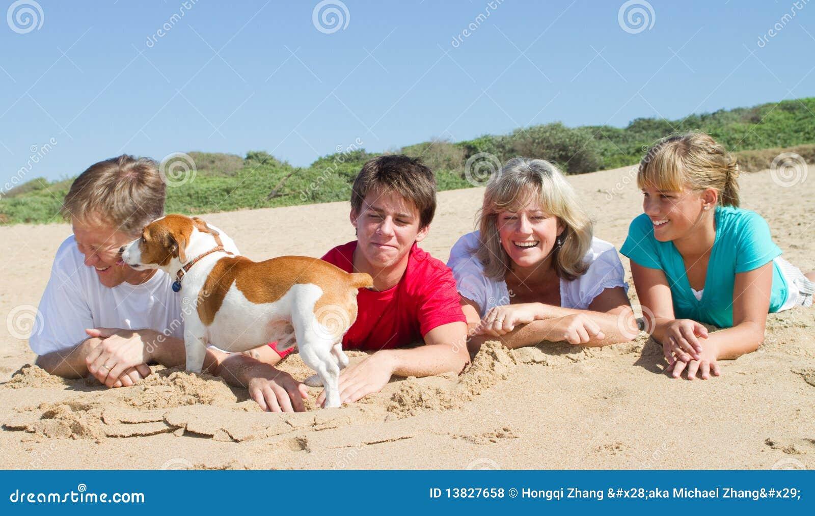 Family lying on beach