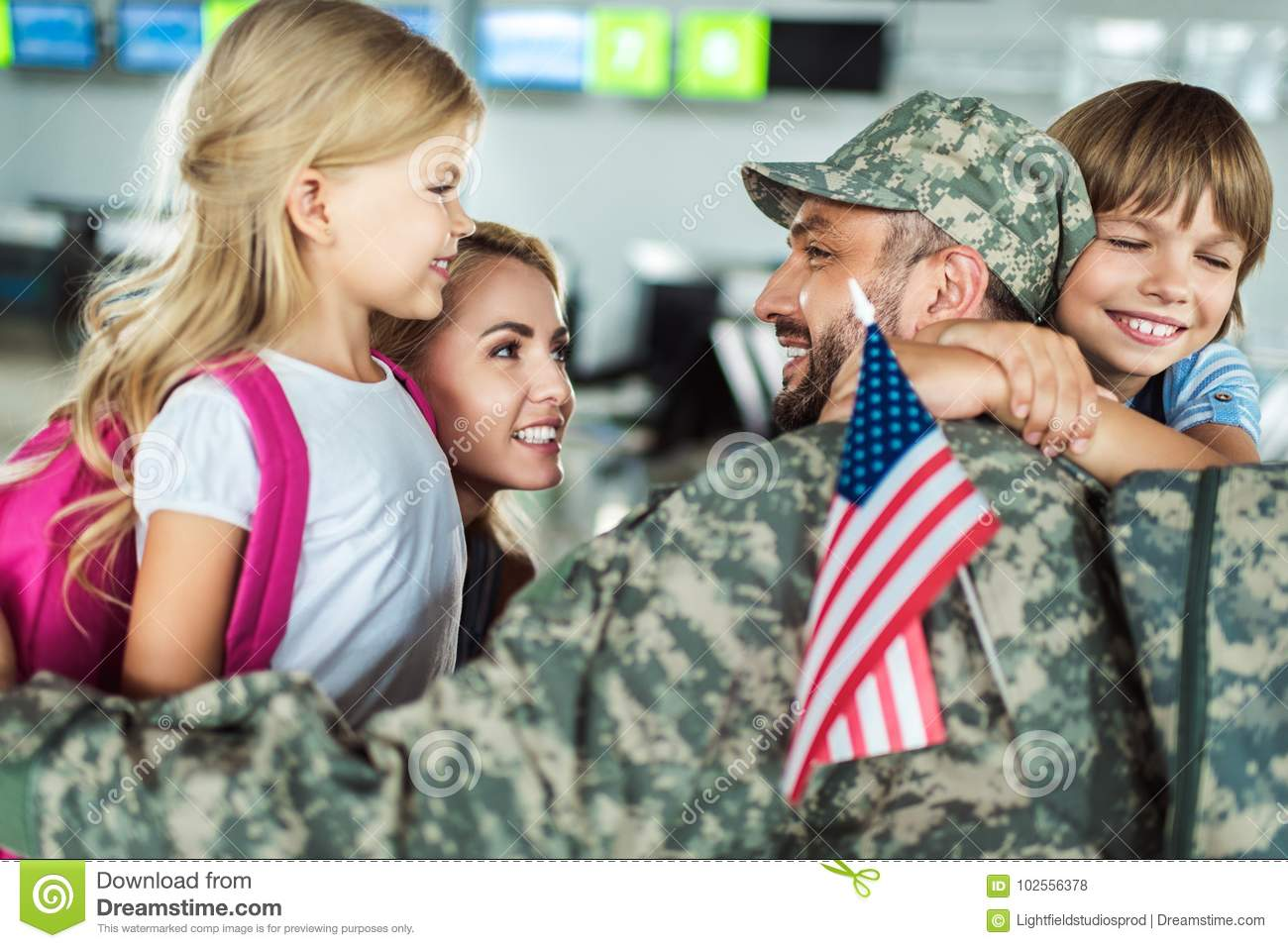 Family and man in military uniform