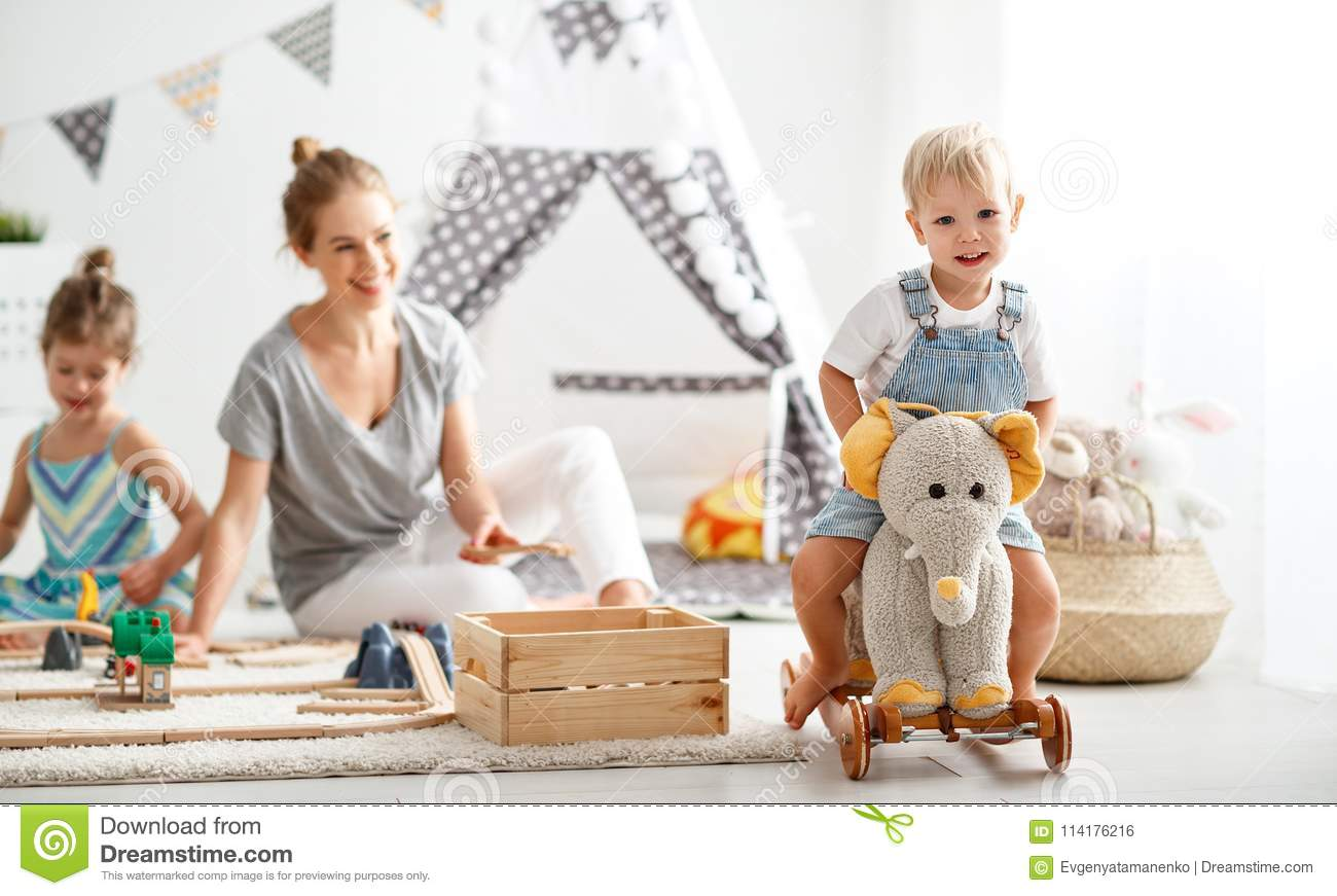 Family Mother And Children Play A Toy Railway In Playroom Stock