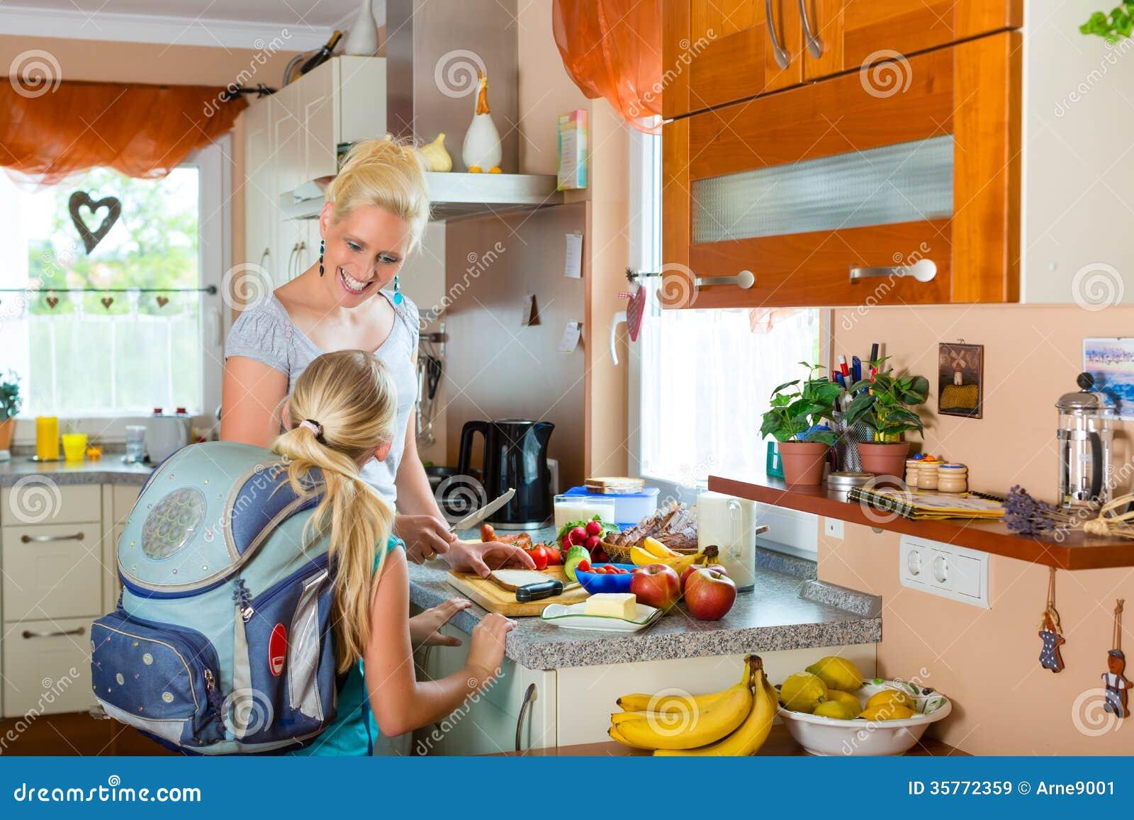 Family Mother Making Breakfast For School Stock Image
