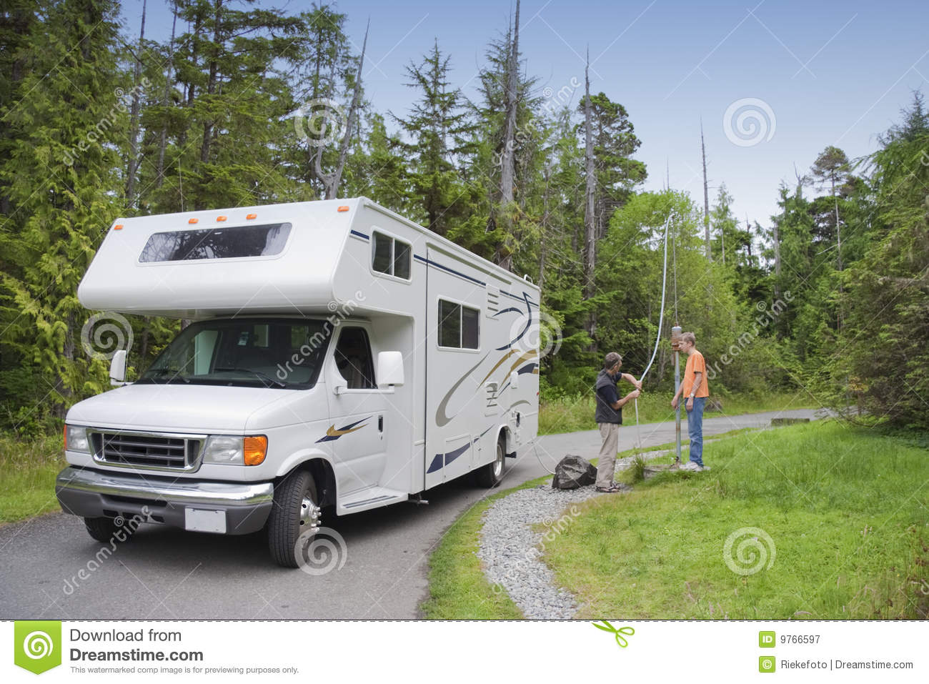 Family With Motor Home At Dumping Station Royalty Free