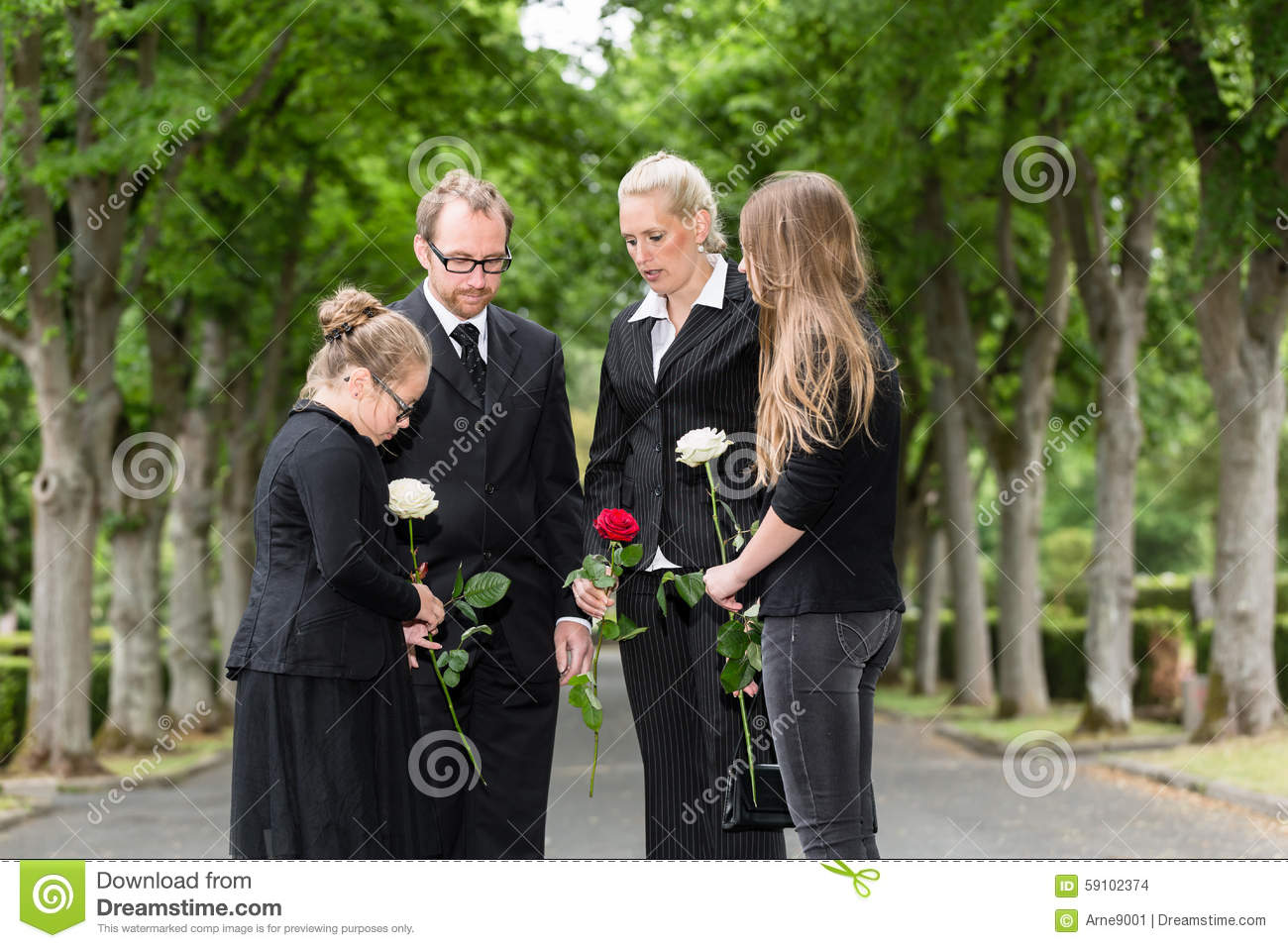 Family mourning on funeral at cemetery