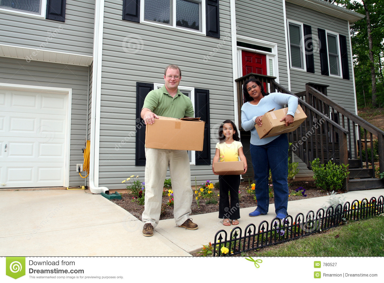 A Family Moving Into New House Royalty Free Stock