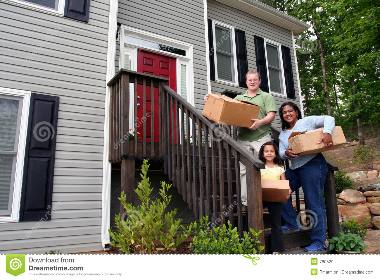 A Family Moving Into New House Royalty Free Stock Images