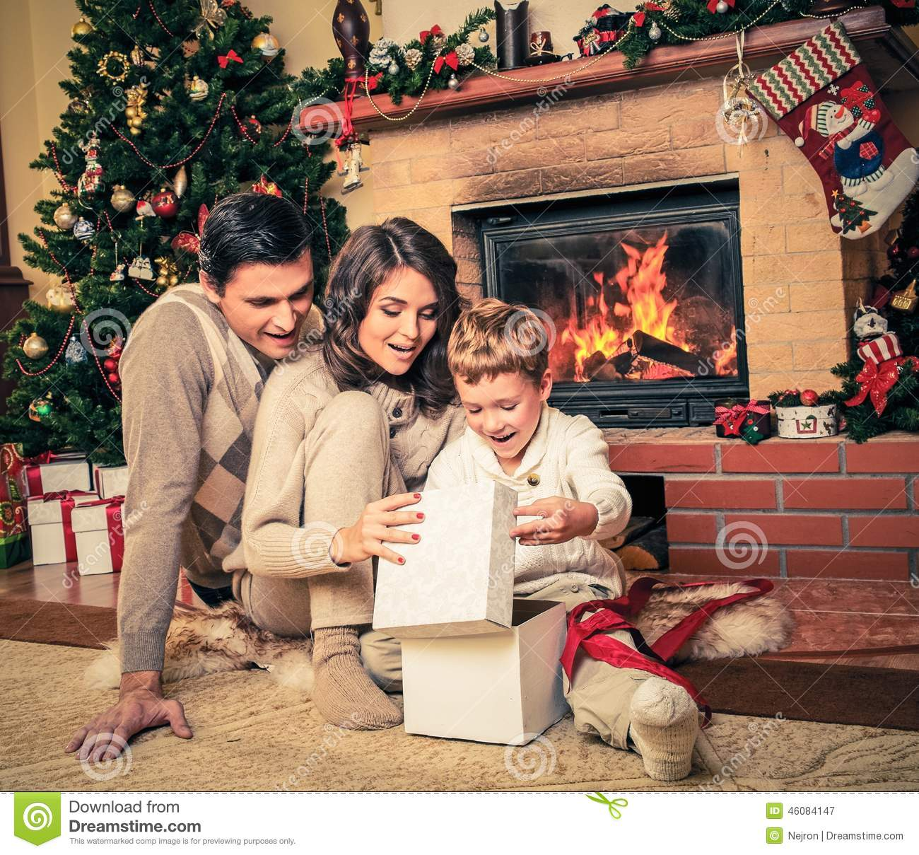 Family Near Fireplace In Christmas Decorated House Stock Photo ...