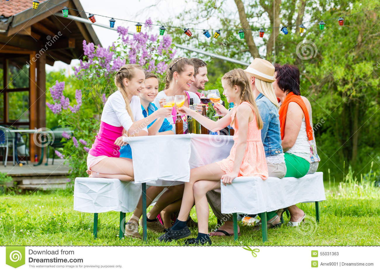Family And Neighbors At Garden Party Drinking