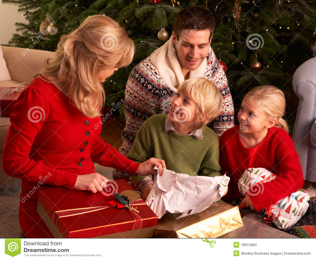Family Opening Christmas Gifts At Home Stock Images ...