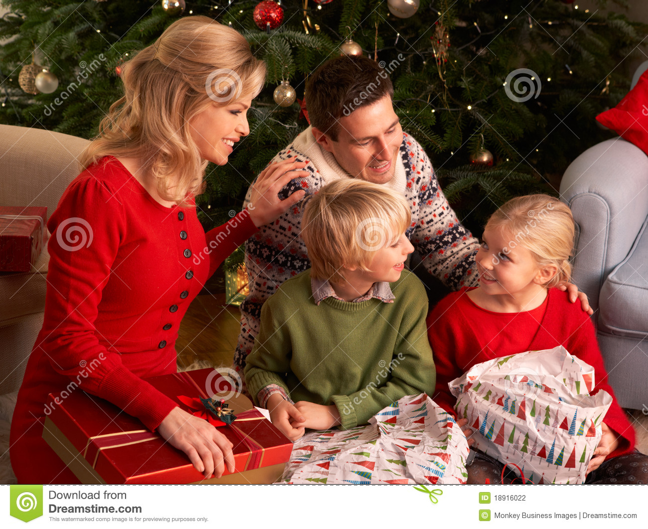 Family Opening Christmas Gifts At Home Stock Photo - Image of ...