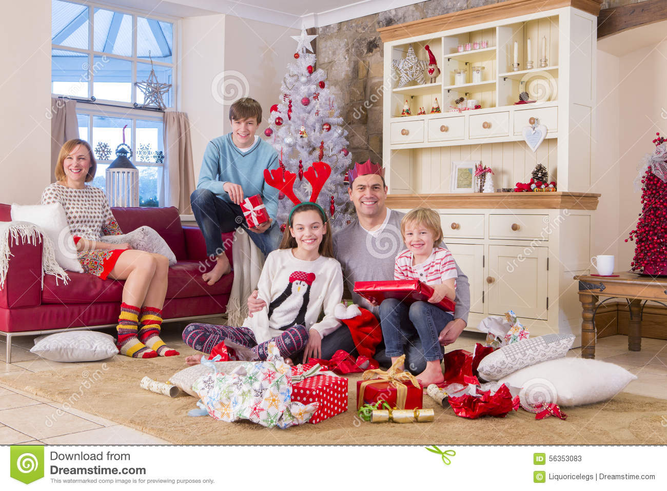 Family Opening Presents At Christmas Time Stock Photo ...