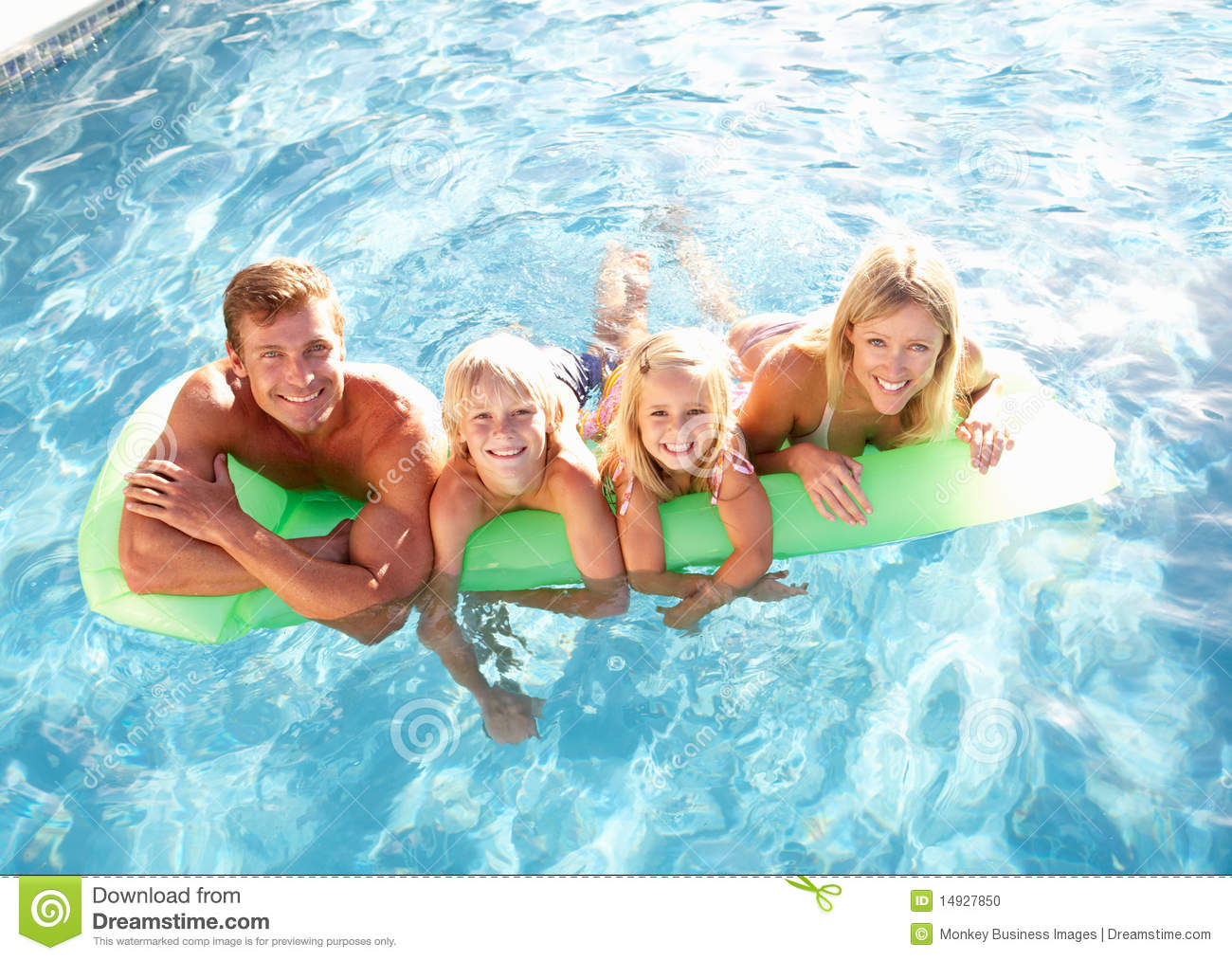 Family outside relaxing in swimming pool stock photo - Wetherby swimming pool swim times ...
