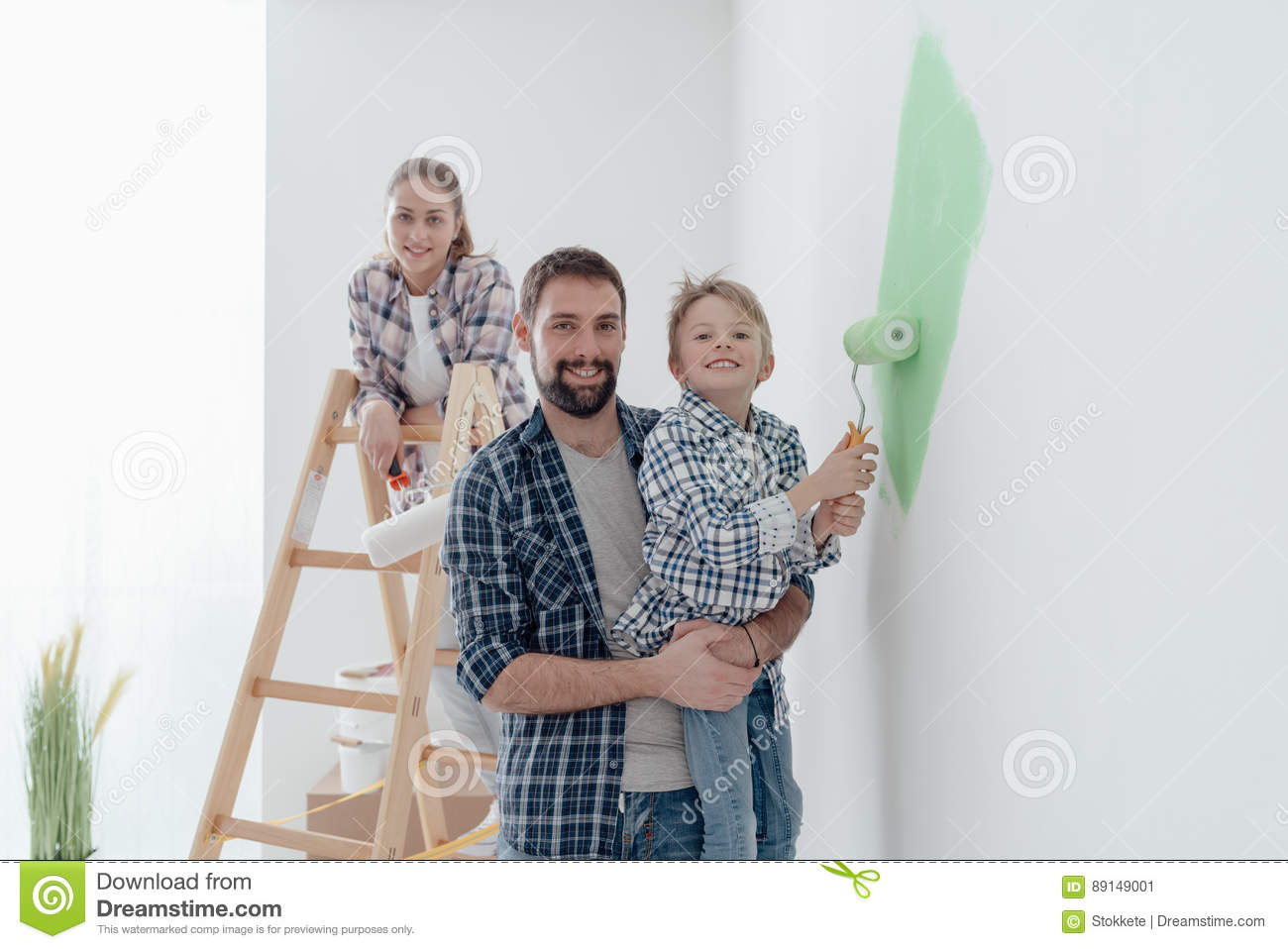 Download Family Painting A Room Together Stock Image