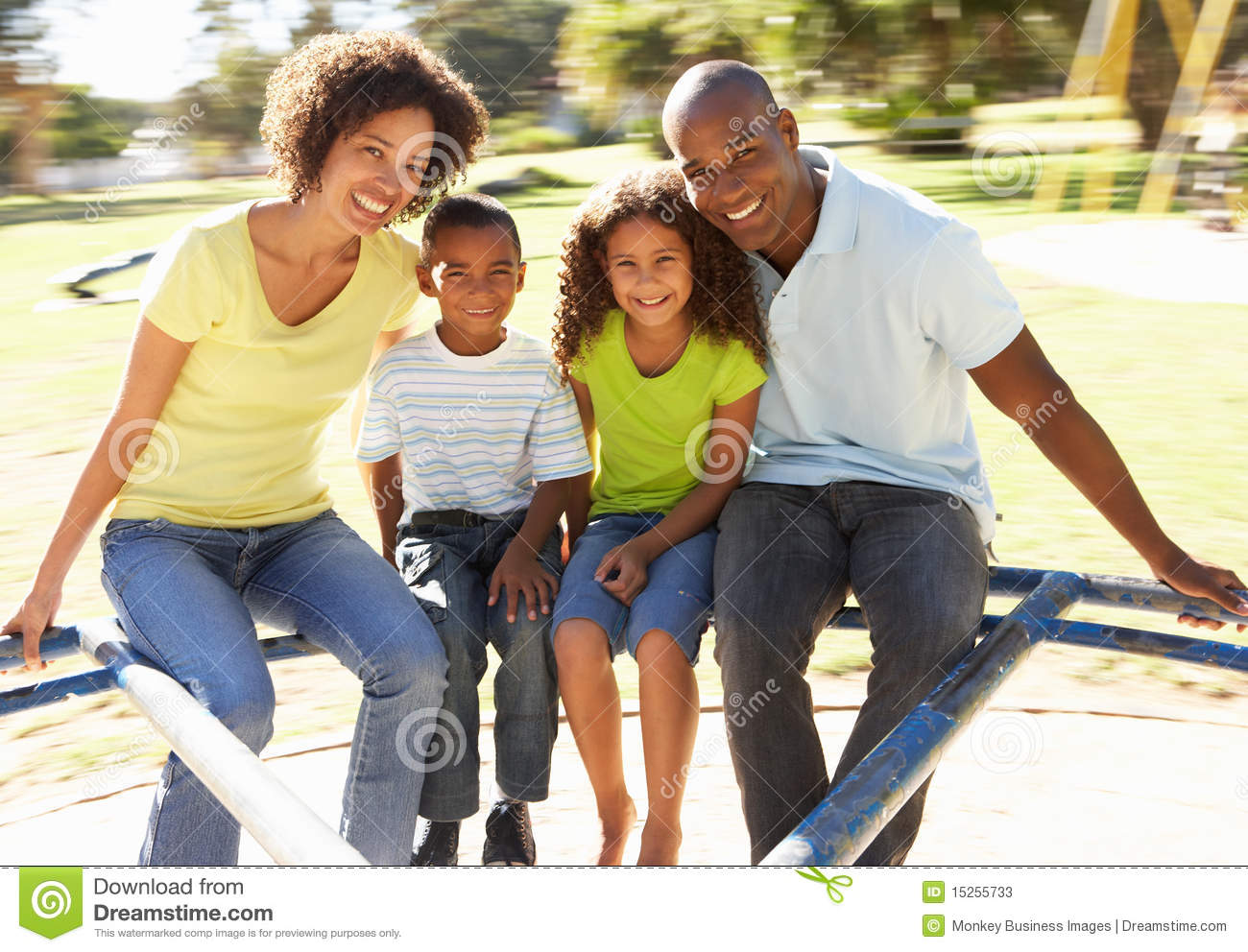 Download Family In Park Riding On Roundabout Stock Image - Image of families, children: 15255733