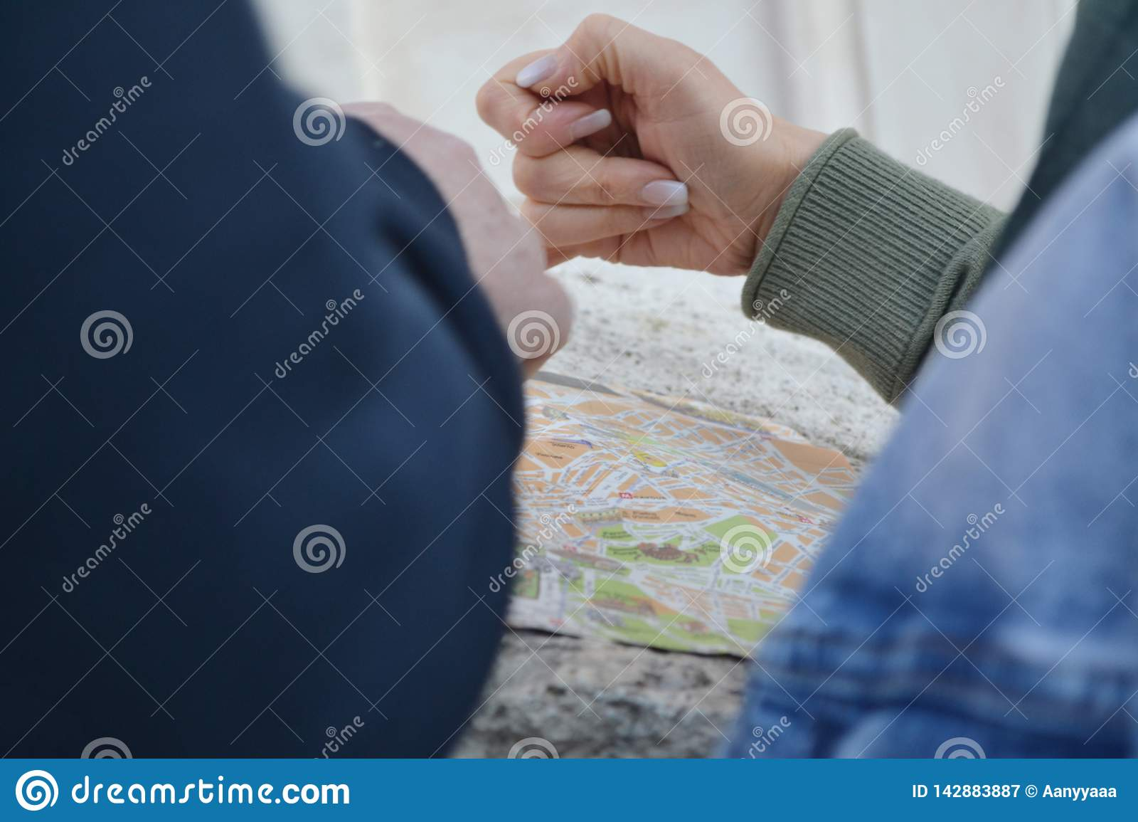 Peaple hands choicing way on the traveling map