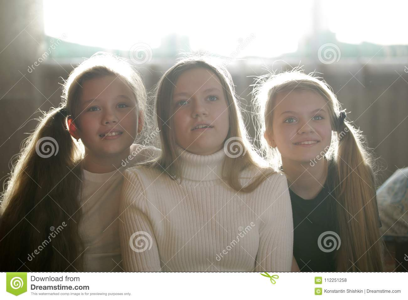Family photo of sisters - three teen girls at home