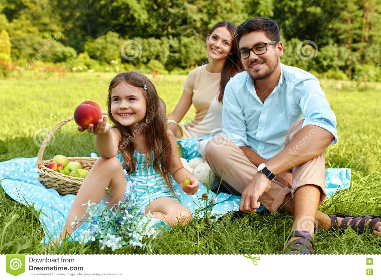 60873983587 Family On Picnic. Happy Beautiful Young Family Spending Leisure Time  Together In Park