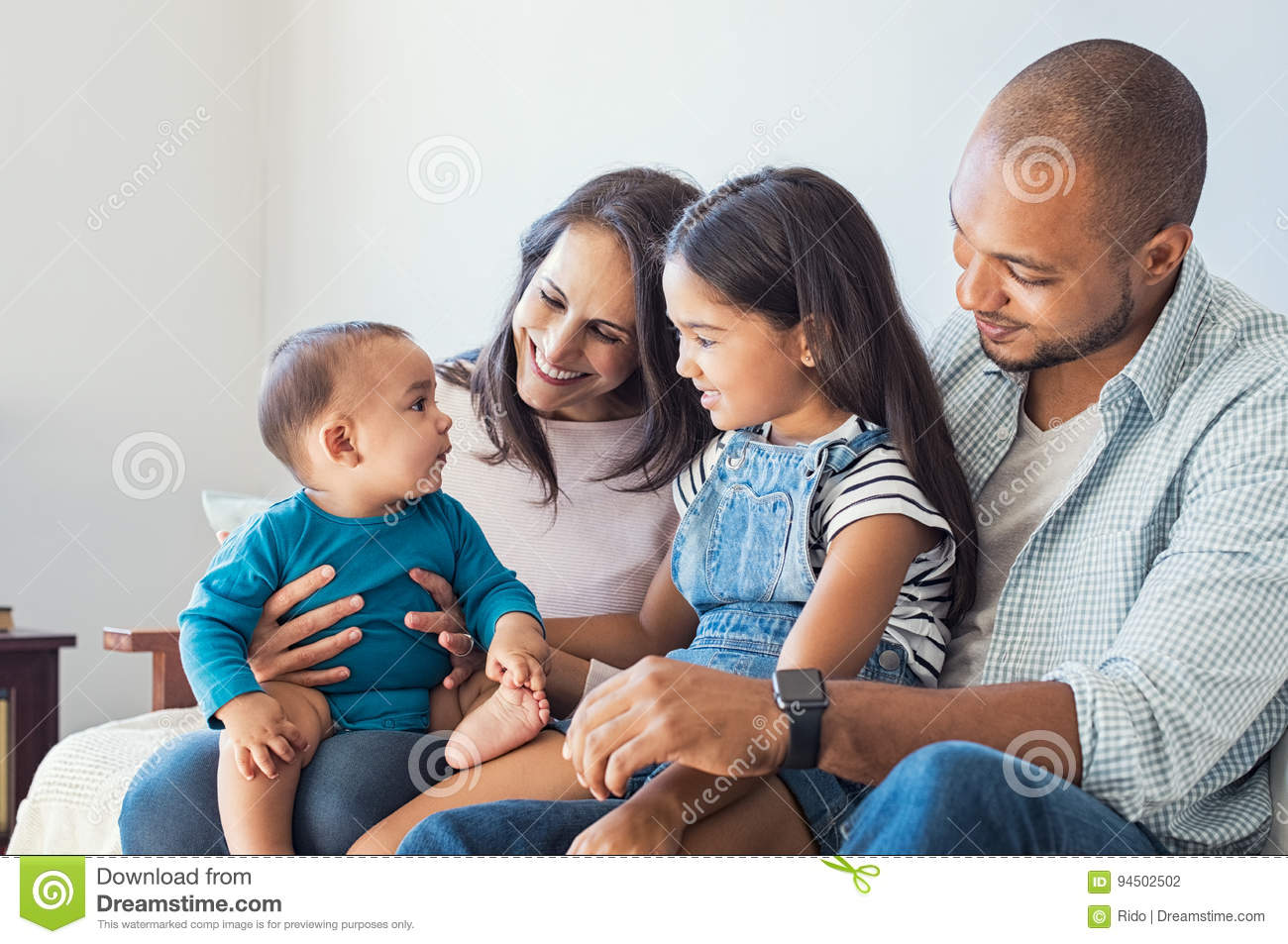 Family playing with baby