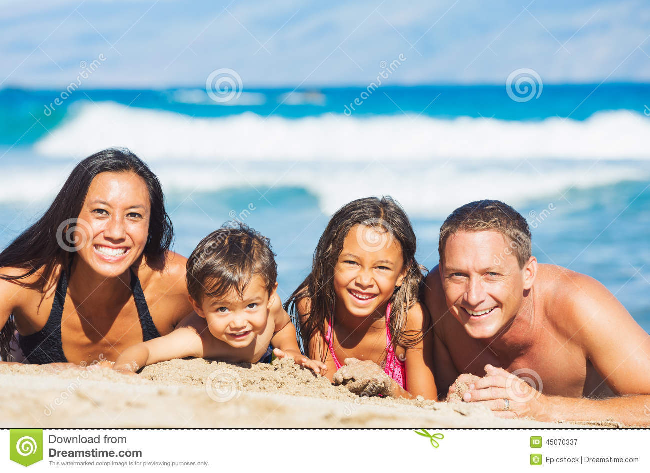 Family Playing On The Beach Stock Photo - Image: 45070337