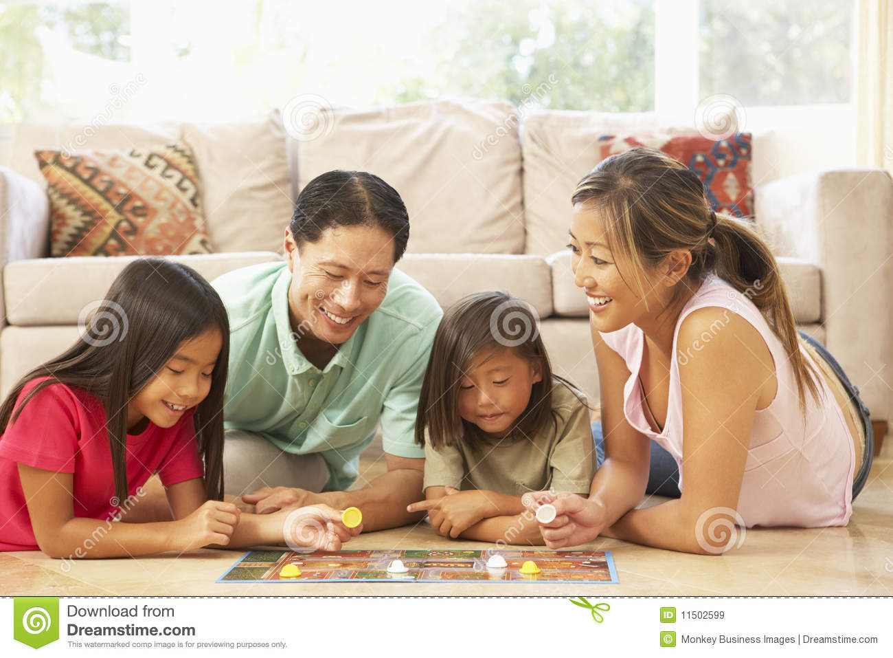 Family Playing Board Game At Home Royalty Free Stock