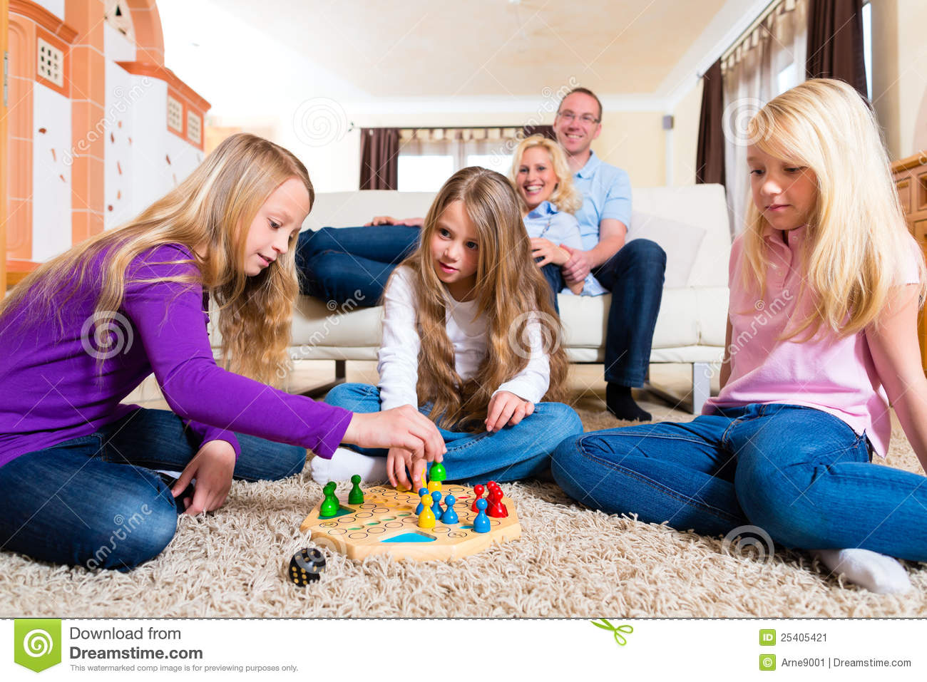 Family Playing Board Game At Home Stock Image Image