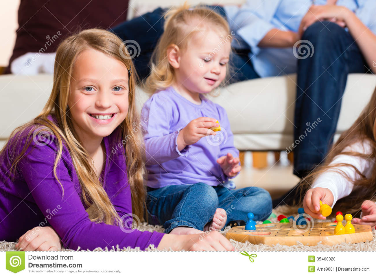 Family Playing Board Game At Home Stock Photo Image