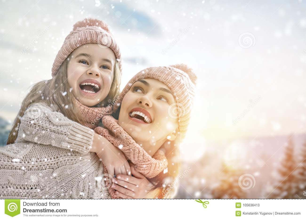 Family playing on winter walk