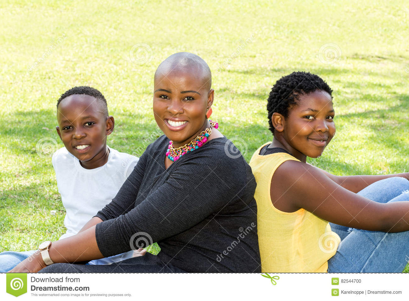 Family portrait of african mother with two kids.
