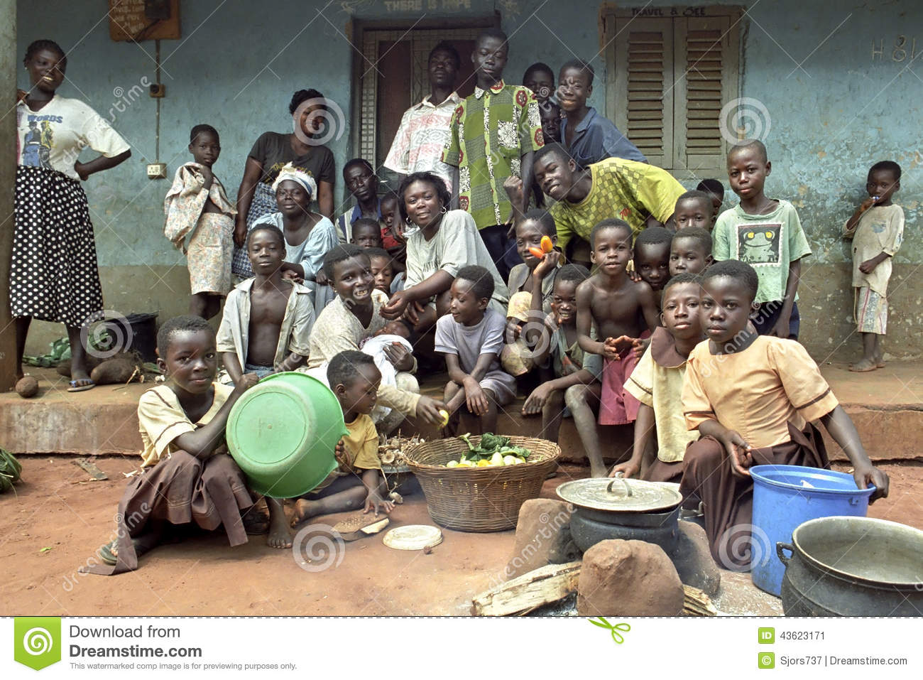 Happy family in front of house together with - Family Portrait Of Ghanaian Extended Family Editorial